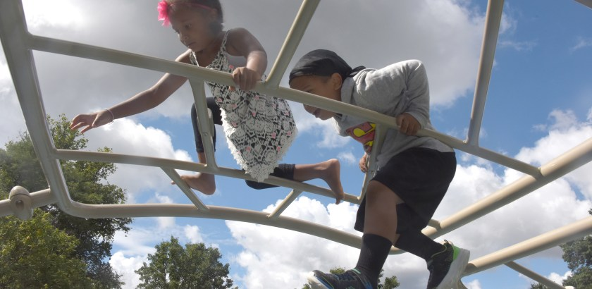 Darrell Sapp/Post-Gazette /Pittsburgh — 08/22/2016 — for Local — STAND ALONE — Climbing High at Anderson Playground— Jael (cq) Smith, 5 years old , and her brother Lee Smith , age 4,  climb high at the Anderson Playground in Schenley Park.  Both are from Schenley Heights and will start kindergarten and pre-school tuesday morning.  They were with their grandmother  Janicee Williams of the Hill District.      digital image #dsc_4589     slug — 20160822dsUpHighLocal.jpg