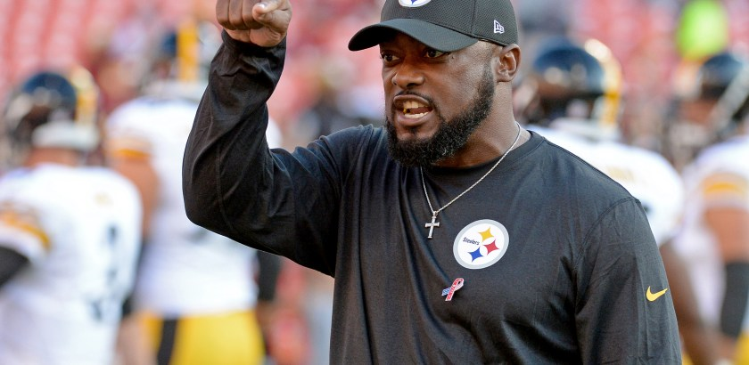Steelers head coach Mike Tomlin motions to fans before his team takes on the Redskins Monday at FedEx Field. (Matt Freed/Post-Gazette)