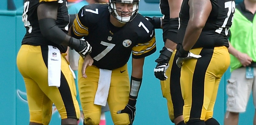 Steelers quarterback Ben Roethlisberger holds his left knee after getting injured in the second quarter against the Dolphins Sunday at Hard Rock Stadium.