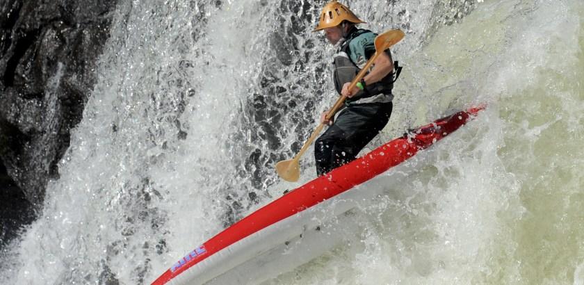 Lake Fong/Post-Gazette 10152016 Standalone Local Jeff Snyder of Accident, Md., goes over the  the waterfalls on his stand-up style kayak in the 17th Annual Ohiopyle Over The Falls Festival on Saturday, October 15, 2016.