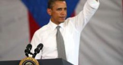 President Barack Obama waves to a cheering crowd that welcomed him to Puerto Rico Tuesday.