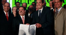 Senate Minority leader Jos Dalmau and Gov. Fortuo hold up the MOU signed Tuesday.  (Credit: La Fortaleza)