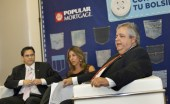 Gilberto Monzn (right) discusses Popular Mortgage&#039;s results, as Pablo Prez (left) and Mariel Arraiza (center) look on.
