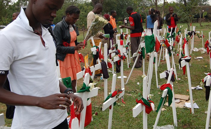 (RNS1-april9) Youth light candles at Freedoms Corner to remember students killed by Al-Shabaab at Garissa University College. For use with RNS-KENYA-MUSLIMS, transmitted on April 9, 2015, Religion News Service photo by Fredrick Nzwili