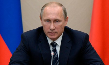 Russian President Vladimir Putin holds a meeting with senior government officials at the Novo-Ogaryovo residence outside Moscow, Russia, on Wednesday, Sept. 30, 2015. Russian military jets carried out airstrikes against the Islamic State group in Syria on Wednesday for the first time, after President Vladimir Putin received parliamentary approval to send Russian troops to Syria. (Alexei Nikolsky/RIA Novosti, Kremlin Pool Photo via AP)