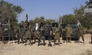 FILE - In his file image taken from video released late Friday evening, Oct. 31, 2014, by Boko Haram, Abubakar Shekau, centre, the leader of Nigeria's Islamic extremist group.  Boko Haram fighters have shot or burned to death about 90 civilians and wounded 500 in ongoing fighting in a Cameroonian border town near Nigeria, officials in Cameroon said Thursday, Feb. 5, 2015.  (AP Photo/Boko Haram,File)