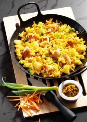 Reis-Rezepte: Curry-Risotto mit Huhn Foto: Wirths PR