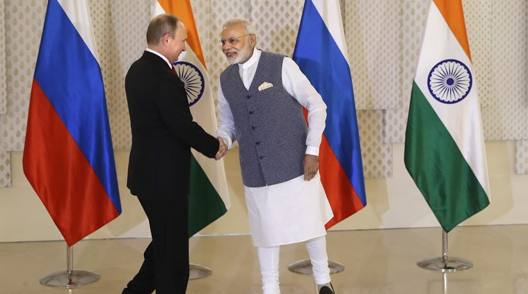 Indian Prime Minister Narendra Modi, right, shakes hand with Russian President Vladimir Putin prior to their annual bilateral meeting, in Goa, India, Saturday, Oct. 15, 2016. (AP Photo/Manish Swarup)