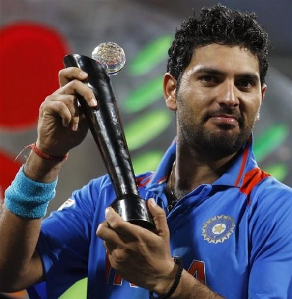India's Yuvraj Singh poses with the Man of the Tournament award after India won the Cricket World Cup final match between Sri Lanka and India in Mumbai, India, Saturday, April 2, 2011.  (AP Photo/Aijaz Rahi)