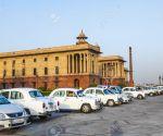 16377520-DELHI-INDIA-OCTOBER-16-Official-Hindustan-Ambassador-cars-parked-outside-North-Block-Secretariat-Bui-Stock-Photo
