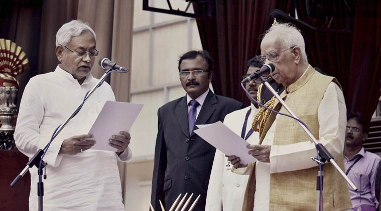 Patna: Bihar Governor Keshari Nath Tripathi administers oath to JD(U) National President Nitish Kumar as Bihar Chief MInister at Raj Bhawan, in Patna on Thursday. PTI photo (PTI7_27_2017_000002B)