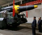 624813-kim-jong-un-inspects-the-long-range-strategic-ballistic-rocket-hwasong-12-reuters