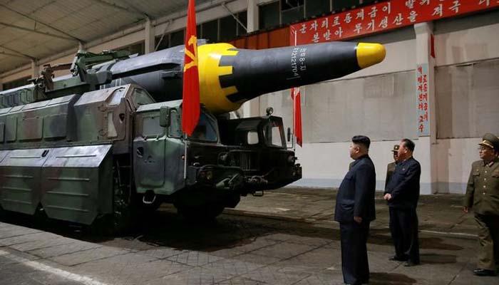 624813-kim-jong-un-inspects-the-long-range-strategic-ballistic-rocket-hwasong-12-reuters