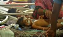 Gorakhpur: Children receive treatments in the Encephalitis  Ward at the Baba Raghav Das Medical College Hospital where over 60 children have died over the past one week, in Gorakhpur district on Monday. PTI Photo  (PTI8_14_2017_000144B)