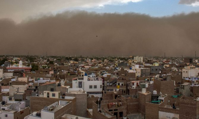 Bikaner: A dust storm approaches the city of Bikaner on Wednesday. PTI Photo (PTI5_2_2018_000173B)