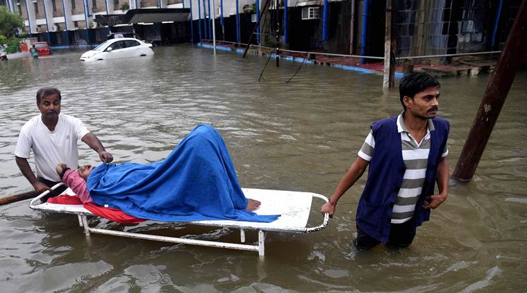 Patna: A patient leaves from Nalanda Medical College and Hospital (NMCH) following waterlogging after heavy monsoon rains in Patna, Saturday, Sept. 28,2019. (PTI Photo)(PTI9_28_2019_000039A)
