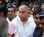 Mumbai: Peter Mukerjea is escorted after being produced by the CBI at the Esplanade court in Mumbai on Friday in connection with Sheena Bora murder case. PTI Photo by Shashank Parade (PTI11_20_2015_000125B)