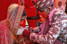 Delhi, May 10 (ANI): An Indian couple performs marriage rituals wearing a protective mask on their wedding after the government eased a nationwide lockdown imposed as a preventive measure against the spread of the COVID-19 coronavirus, in New Delhi on Sunday. (ANI Photo)