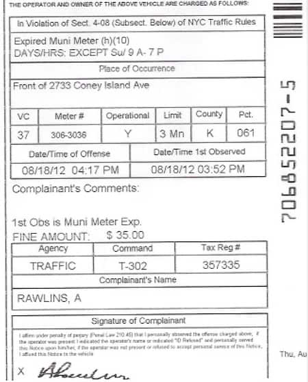 This image is a NYC parking ticket showing the location of the 10 digit summons number