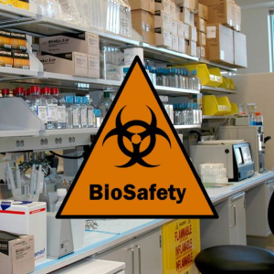 """""""Biosafety"""" and biohazard logo superimposed on a picture of a laboratory workspace"""