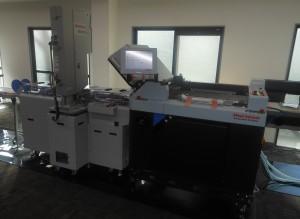 折り機に超音波溶着機を繋いだクリアファイル生産ライン