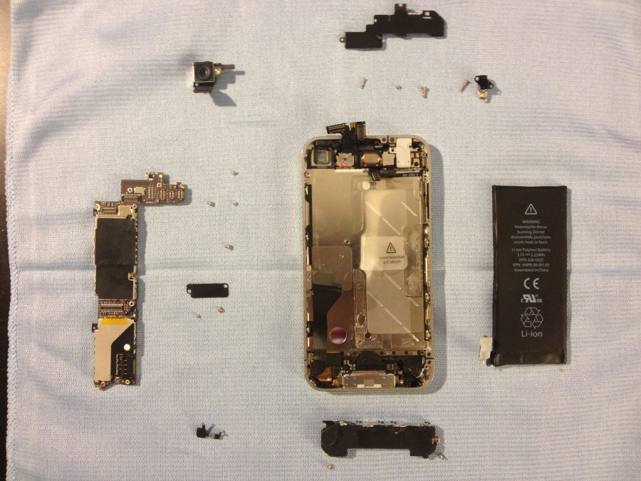 The battery, speaker housing, and motherboard removed.