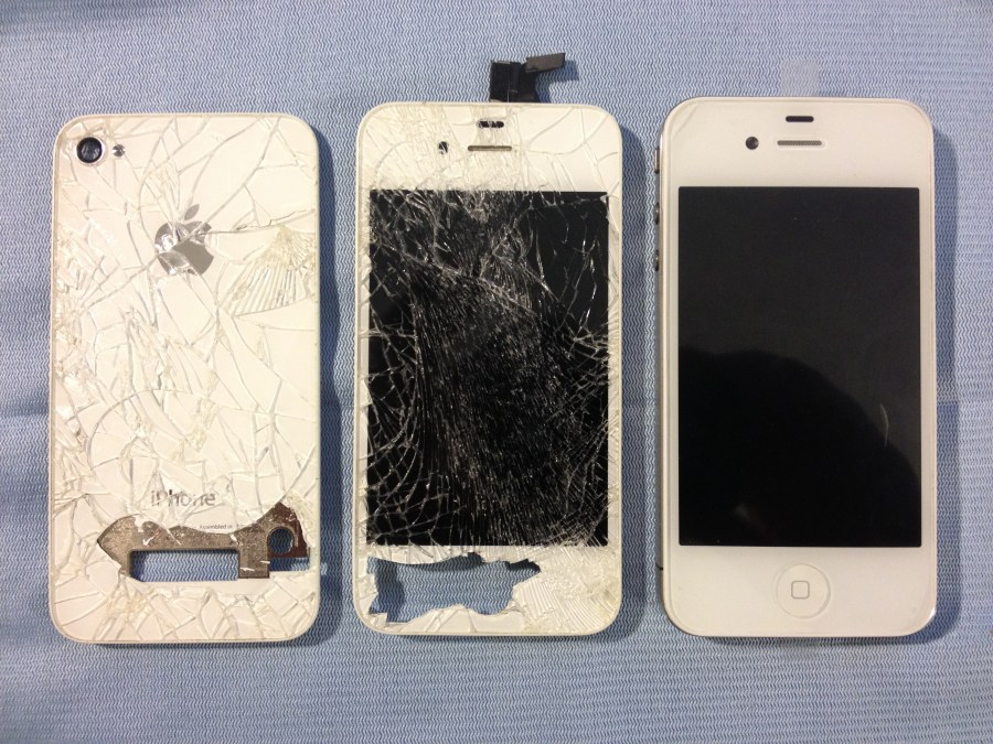 Front of the iPhone, side by side with the old screen and back cover