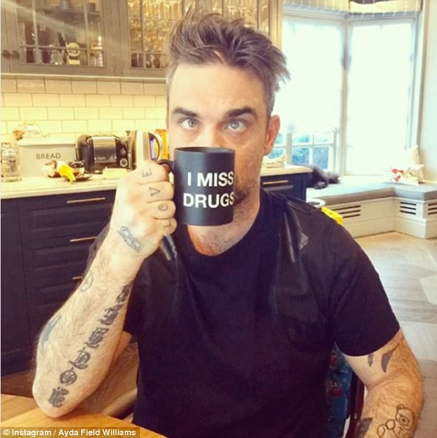 Robbie Williams Makes Fun Of His Former Drug Habits As He Poses With 'I Miss Drugs' Mug!