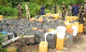 PIC.9. FUEL LADEN KEGS RECOVERED FROM SUSPECTED PIPELINE  VANDALS BY THE JOINT OPERATION OFTHE  MILITARY AND OFFICIALS OF OGUN COMMAND OF NSCDC  AT OGERE-REMO, IKENNE LOCAL GOVERNMENTAREA OF  OGUN ON MONDAY (5/8/13).