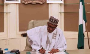 president signing a document