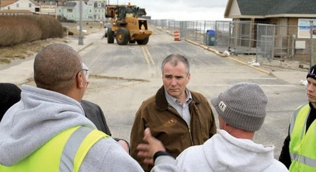 Labor Commissioner Harold J. Wirths talks with a team of workers in Long Branch that were hired through a National Emergency Grant to assist with Sandy recovery work. Commissioner Wirths toured the Long Branch and Union Beach areas with officials from Monmouth County and the U.S. Department of Labor.