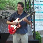 Ron Petrides plays Victoria Row