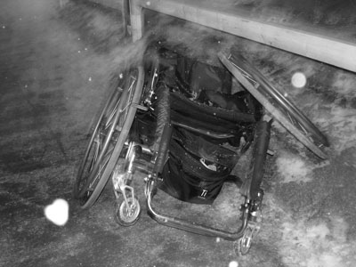 Wheelchair in snow Canada Revenue kicks people in wheelchairs photo