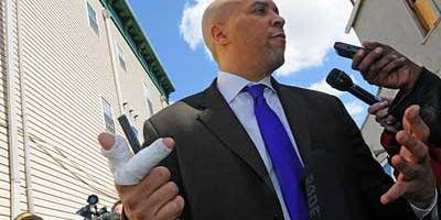 Newark Mayor Cory Booker talks to the media on Friday, April 13, 2012, about rescuing his neighbor from an apartment fire.  (caption NorthJersey.com, photo credit ELIZABETH LARA / STAFF PHOTOGRAPHER)