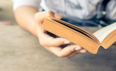 30602681 - closeup woman hand  holding pocket book to read