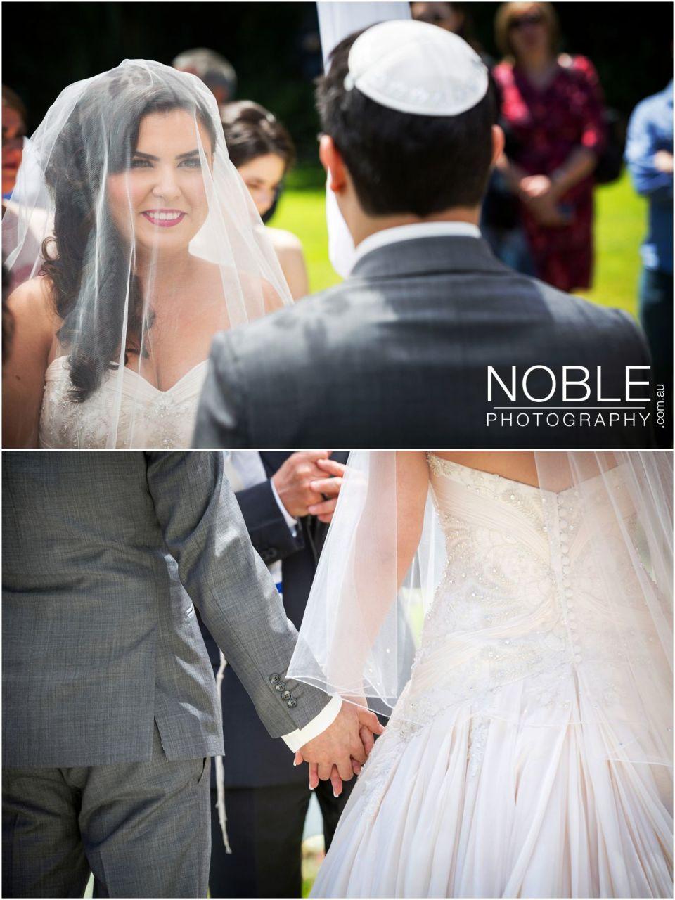 Holding hands at Jewish wedding ceremony