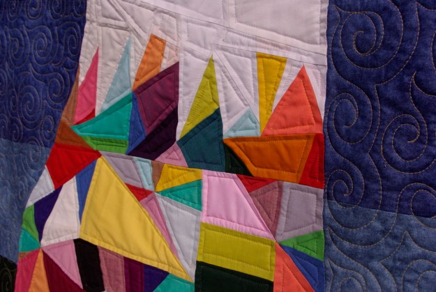 triangle pieced quilt