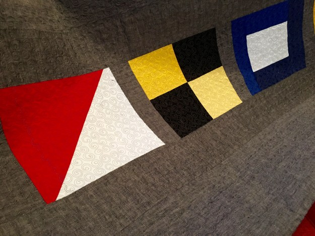 quilting detail, nautical flags