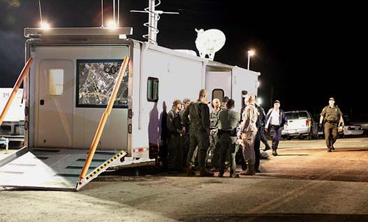 Emergency Responders meeting next to trailer
