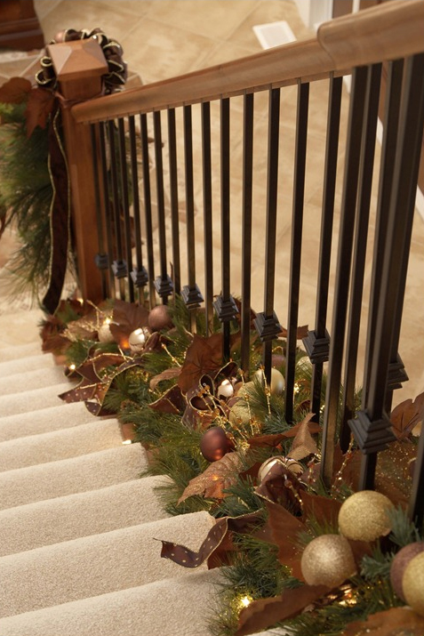 Holiday decor twist garland at the bottom of stair for Hanging garland on staircase