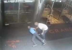 Ex-tennis star James Blake is shown handcuffed by a…