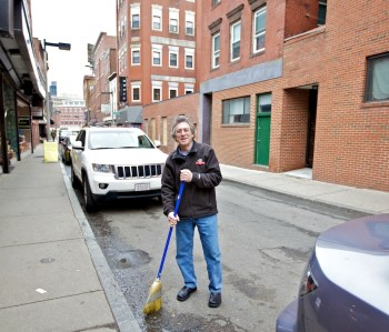 Ken Rothman of Salem Street True Value Sweeping in Front of His Store - Photo by Matt Conti - April 2012