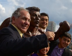 Tony DeMarco poses with his statue and members of the Privitera family