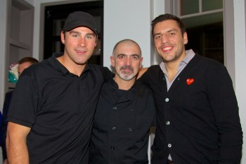 Boston Bruins Players, Johnny Boychuk (left) and Milan Lucic (right) join with Monica's owner, Jorge Mendoza, to support the Eliot School. - Photo by Matt Conti