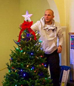 Nick Verrocchi puts the finishing touches on the Nazzaro Community Center Christmas Tree - December 2012 (Photo by Matt Conti)