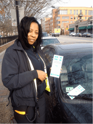 "A City of Boston Parking Enforcement Officer issuing a ""Know Snow"" Pamphlet to a vehicle parked on Washington Street in the South End, adjacent to Peters Park. (City of Boston photo)"