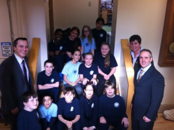 Secretary Matt Malone and State Rep. Aaron Michlewitz with Eliot K-8 Innovation School Principal Traci Walker Griffith and Eliot Grade 6 students at the North Bennet Street / Eliot School site. (Photo courtesy of the Eliot)