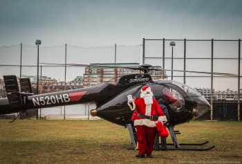 Santa arriving by helicopter for the 2014 Christmas Parade