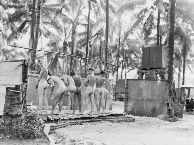 Alexishafen, New Guinea. 1944-09-13. Troops of the 133rd Brigade Workshops enjoying clean-up in the unit showers. (Australian War Memorial, 075851)