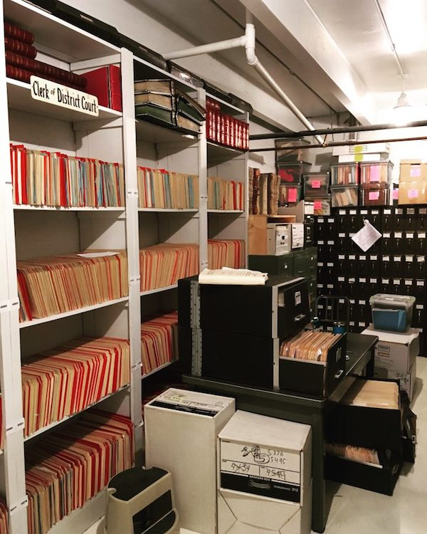 Criminal (red folders) and civil (manila folders) case files. Vault of the Cheyenne County District Court, Cheyenne County Courthouse. Sidney, Nebraska.